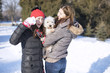 Middle age women with her teenage daughter enjoy in snow